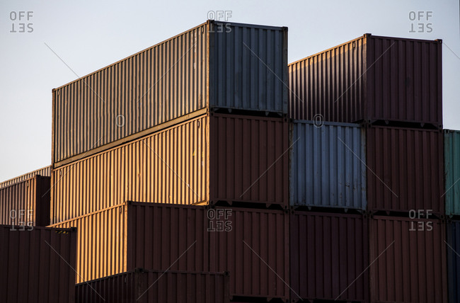 Tall stacks of cargo containers at industrial port