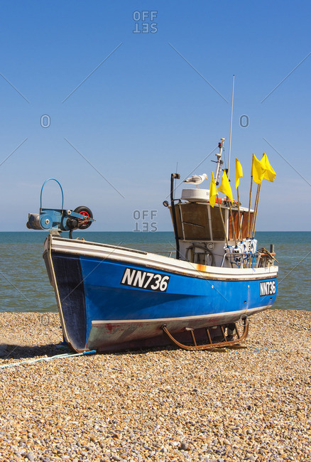 A traditional fishing boat on the shingle beach at Hastings, Sussex, England