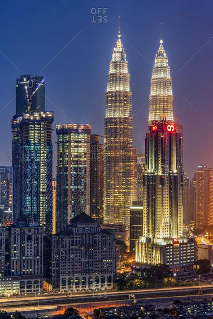 Petronas Twin Towers and city skyline at dusk, Kuala Lumpur, Malaysia