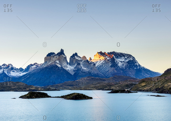 View over Lake Pehoe towards Paine Grande and Cuernos del Paine, sunset, Torres del Paine National Park, Patagonia, Chile