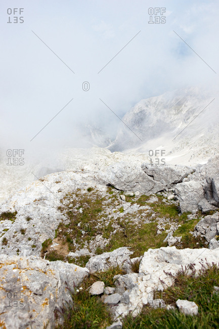 Rugged mountain slope enveloped in clouds