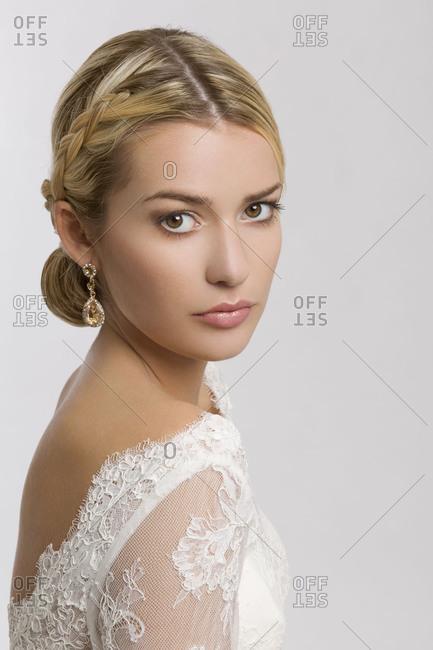 Young woman, bride, wedding dress, bridal make-up, bridal hairstyle