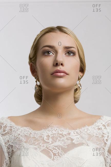 Young woman, bride, bridal make-up, bridal hairstyle, wedding dress