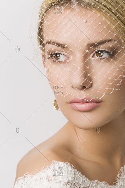 Young woman, bride, veil, wedding dress, bridal make-up