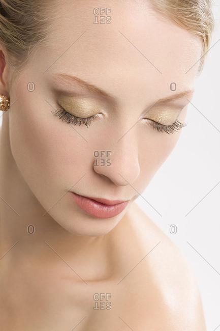 Young woman, bride, bridal make-up, eyes closed
