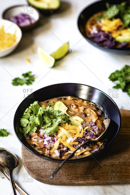 Chicken Chili in a black bowl on a white background