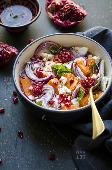 Pumpkin, onion and feta salad with pomegranate