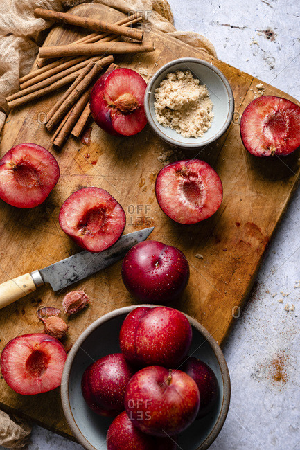 Sliced Red Plums on a wooden chopping board