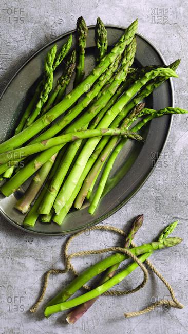 Freshly cut asparagus spears on a plate.