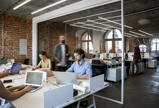 Group of businesspeople working at modern open space office.