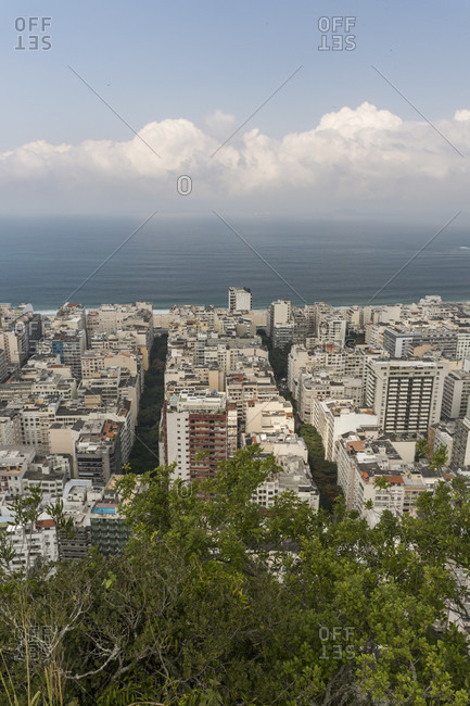 View of buildings in city and beach at Copacabana seen from Agulinha do Inhanga, Rio de Janeiro, Brazil