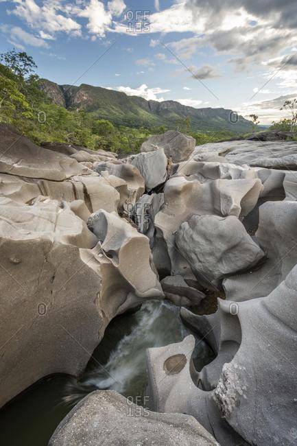 Beautiful landscape with river running among rocks in Vale da Lua Moon Valley, Chapada dos Veadeiros, Goias, Brazil