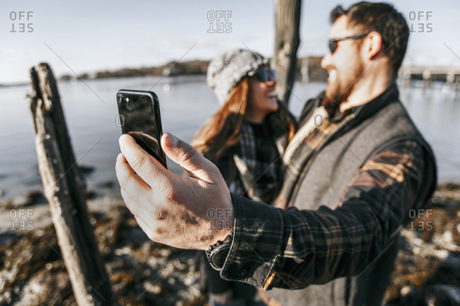 Couple taking?selfie?while hanging out on waterfront, Peaks Island, Maine, USA