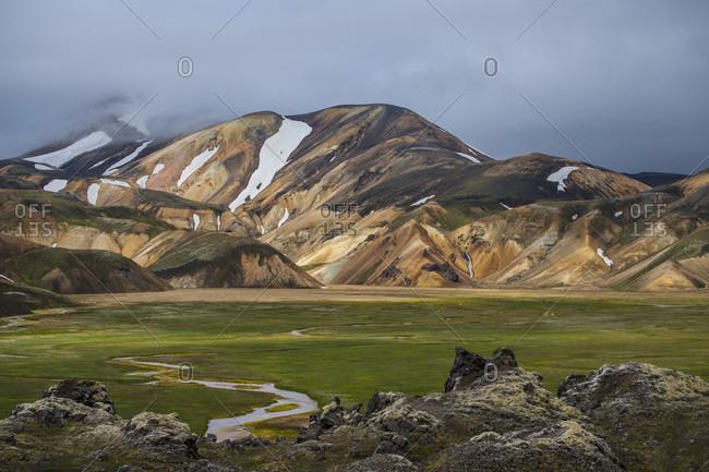 Rolling landscape with rhyolite mountains at Landmannalaugar on Laugavegur hiking trail, Landmannalaugar, Fjallabak, Iceland