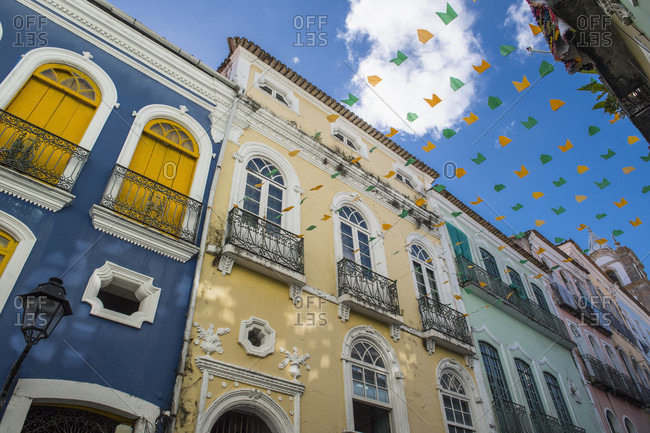 Street in Salvador decorated with colorful flags between buildings at daytime, Salvador, Bahia, Brazil