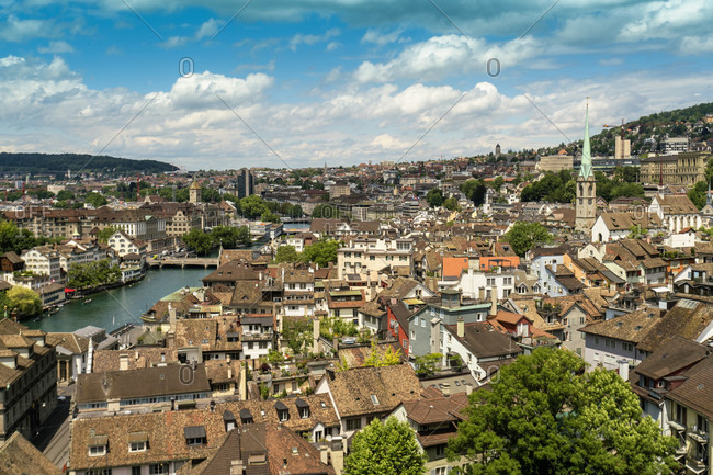 Picturesque cityscape?with characteristic tiled roof along river, Zurich, Switzerland