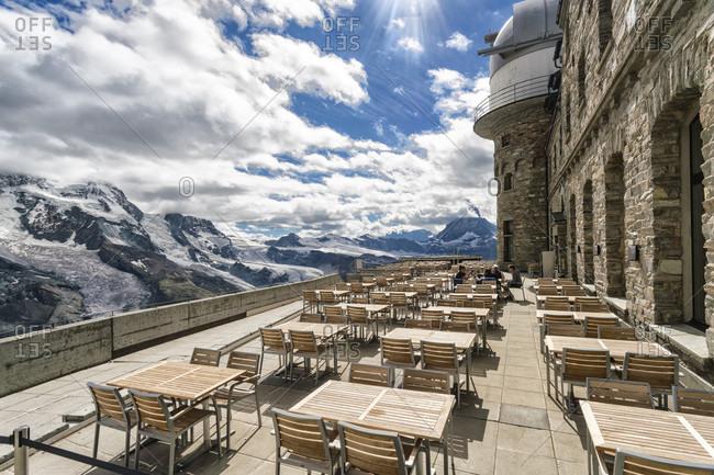 Tables and chairs on terrace of weather station on top of?Gornegrat?summit, ?Zermatt, Valais, Switzerland