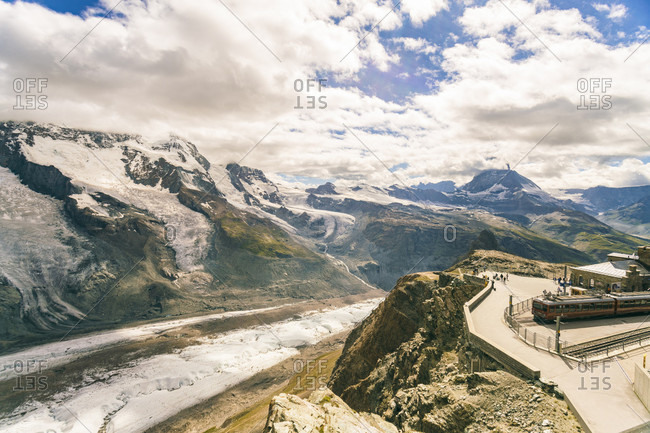 Mountainscape with observation deck and train station in Gornegrat among clouds, ?Zermatt, Valais, Switzerland