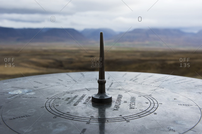 Close-up of metal disc marking Hringsja panoramic point, Hringvegur, Iceland