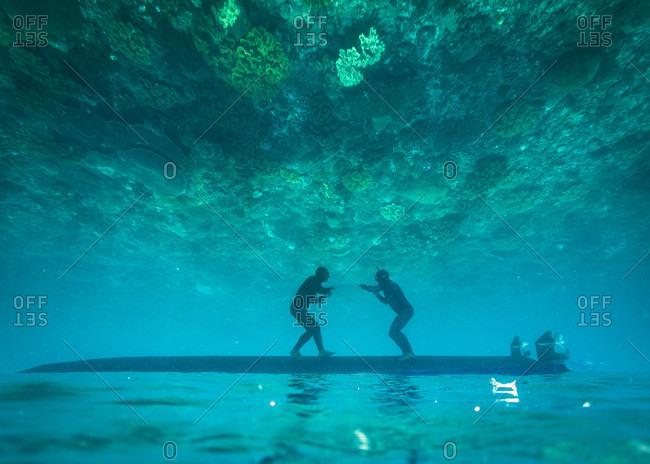 Two freedivers having fun underwater, Nusapenida, Bali, Indonesia