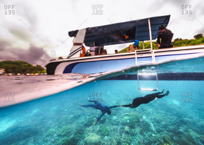 Freedivers having fun underwater, Nusapenida, Bali, Indonesia