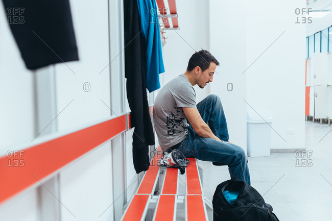 Young man preparing himself in the locker room - preparation, concentration, sportive concept