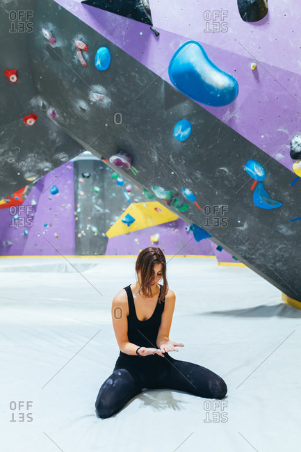 Young man climbing rock wall indoor - healthy lifestyle, sport, climbing concept