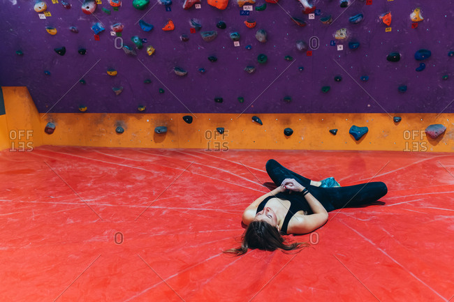 Two young adult climbing rock wall indoor - healthy lifestyle, sport, climbing concept