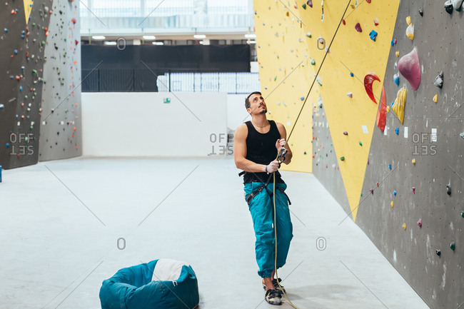 Three people climbing rock wall indoor - healthy lifestyle, sport, climbing concept
