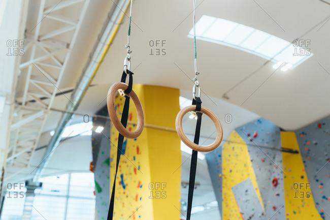 Low angle view of gymnastic rings hanging on ceiling