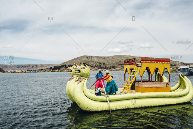 Lake Titicaca, Peru - November 23, 2017: Traditional reed tour boat