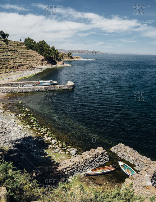 Boats moored on the shores of Lake Titicaca, Peru