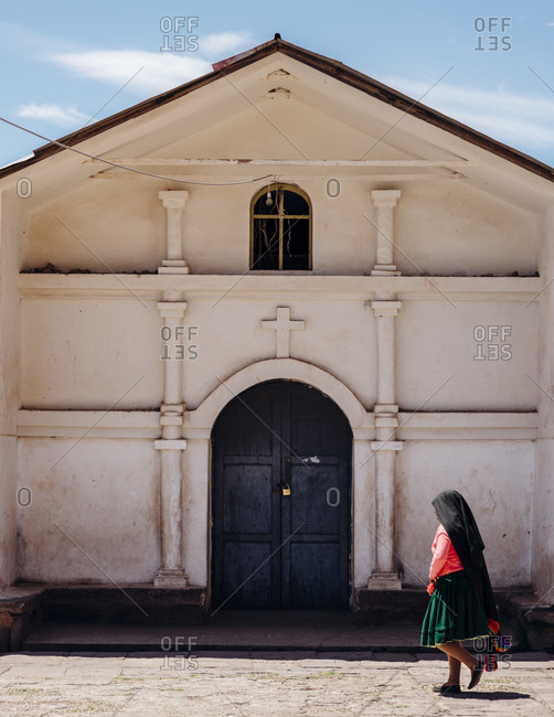 Lake Titicaca, Peru - November 24, 2017: Nun walking by church