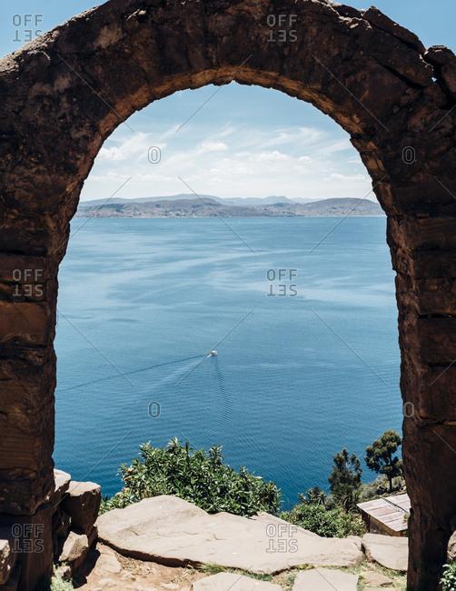 View through arch of Lake Titicaca, Peru