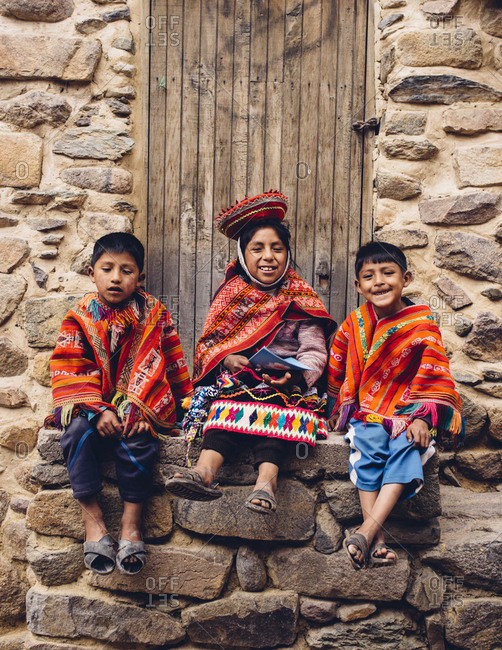 Sacred Valley, Peru - November 17, 2017: Children dressed in traditional clothing in the Sacred Valley, Peru