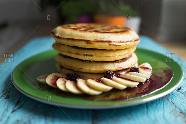 Stack of homemade pancakes and banana slices