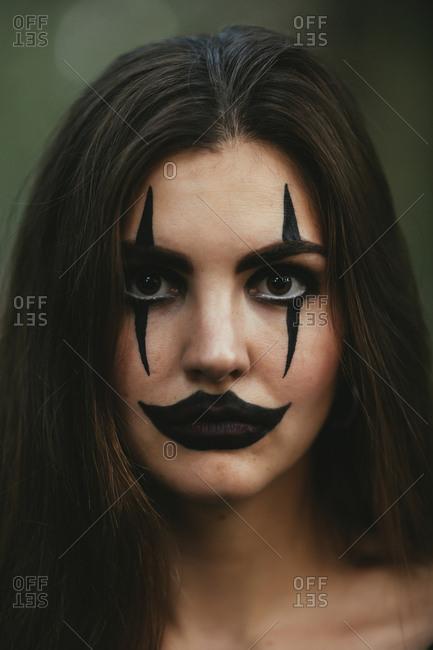 Girl wearing creepy makeup for Halloween