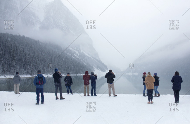 Alberta, Canada - October 28, 2018: Tourists enjoying early winter snow at Lake Louise, Banff National Park, Alberta, Canada
