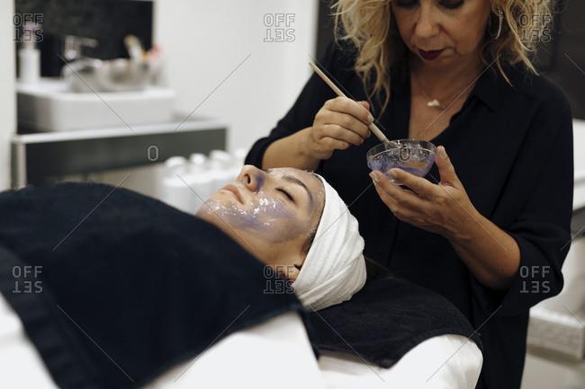 Woman receiving facial in a spa