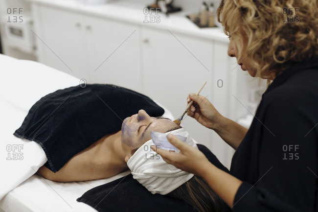 Woman getting a facial in a spa