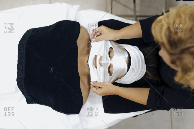 Woman having mask applied in a spa
