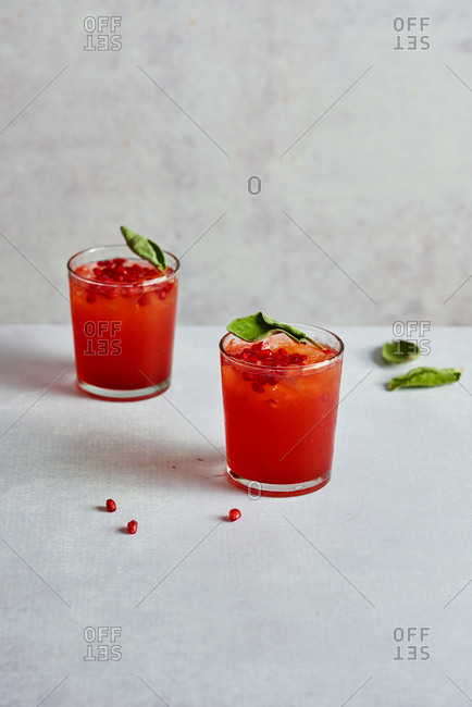 Festive cocktails with sage cranberry juice and pomegranate seeds