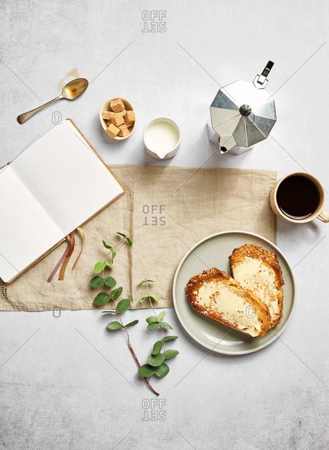 Minimal breakfast scene with diary