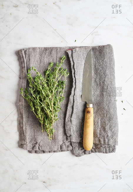 Thyme and a knife on cloth napkin