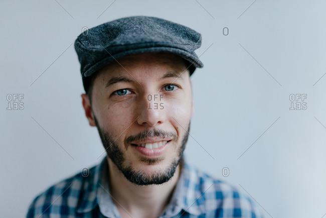 Man wearing flat cap looking at camera stock photo - OFFSET 1fccb93156e