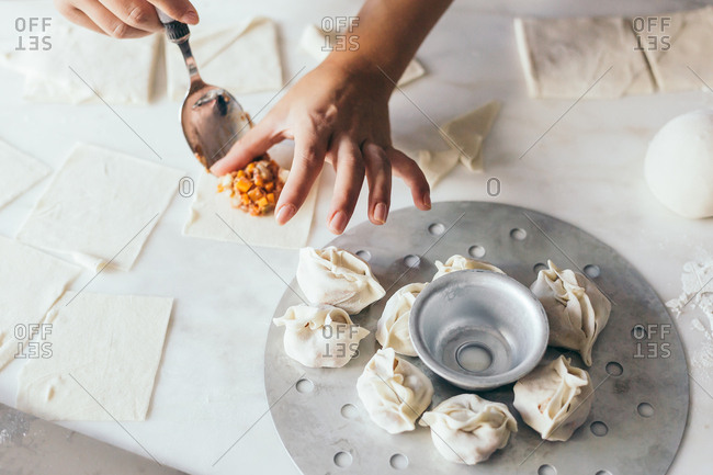 Girl preparing the far east meal Manti
