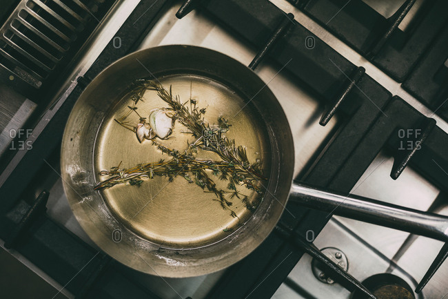 Garlic, rosemary and olive oil in a metal pan