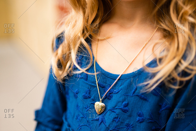 Close up of a locket on young girl's neck