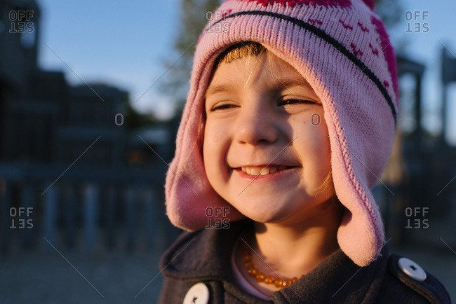 Portrait of a little girl in a pink hat