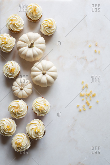 Pumpkin cupcakes with candied ginger on marble surface